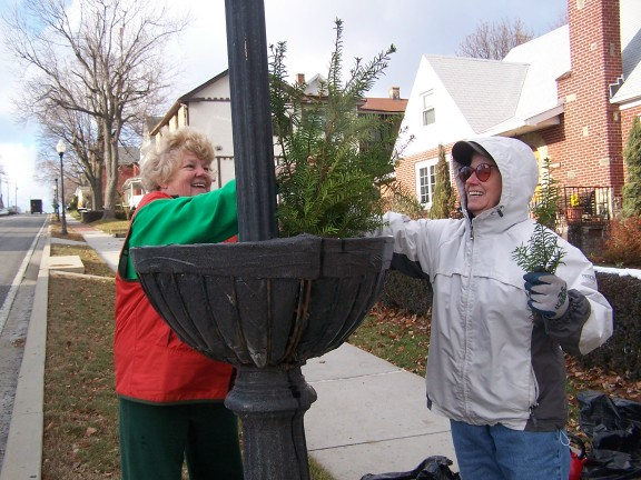 garden club members decorate planter